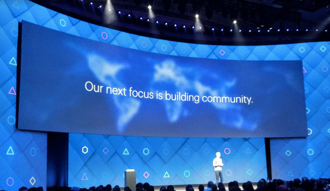 Facebook CEO on stage at F8 discussing community as focus of company