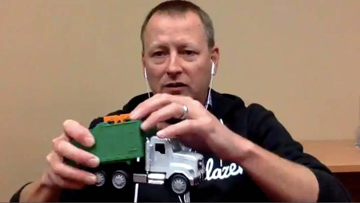 Salesforce's evp Woodson Martin Shows a toy garbage truck with an RFID sensor